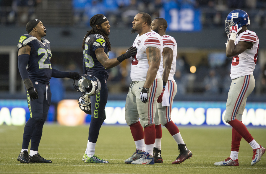 Seahawks cornerback Richard Sherman tries to calm down Giants defensive lineman Cullen Jenkins, who was upset with Seahawks safety Jeron Johnson for a hard hit on Sunday, Nov. 9, 2014 at CenturyLink Field.