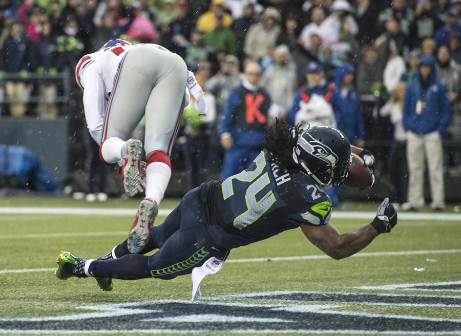 Seattle Seahawk Marshawn Lynch on his way to one of his four touchdowns in the 38-17 win over the New York Giants on Sunday, Nov. 9, 2014 at CenturyLink Field.