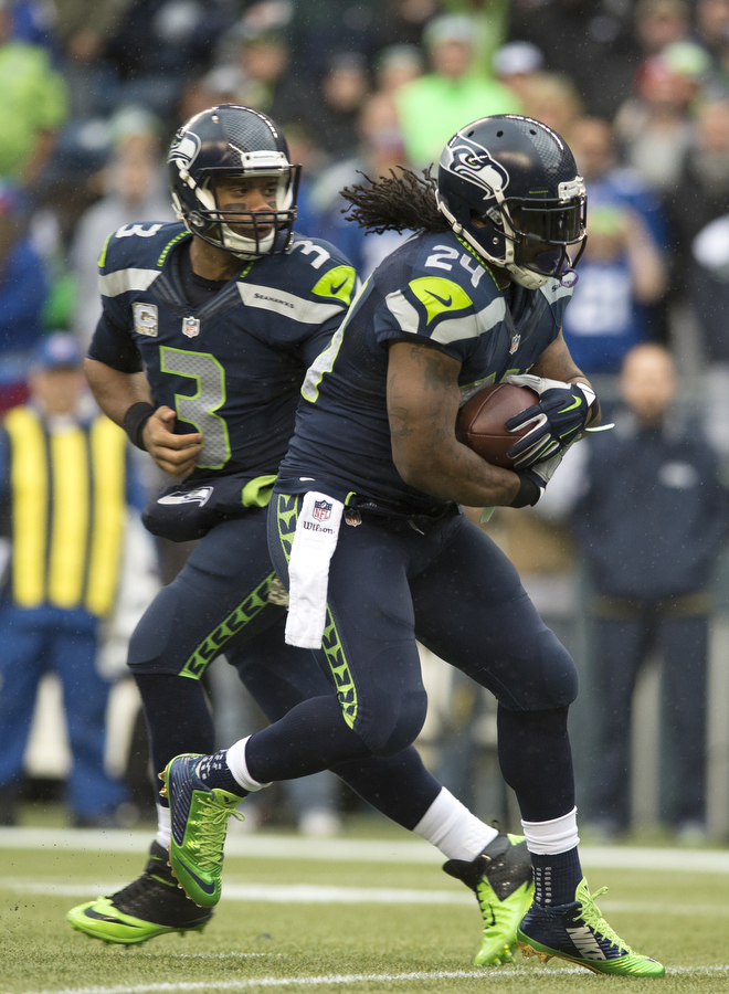 Seahawks quarterback Russell Wilson hands the ball off to Marshawn Lynch on Sunday, Nov. 9, 2014 at CenturyLink Field.