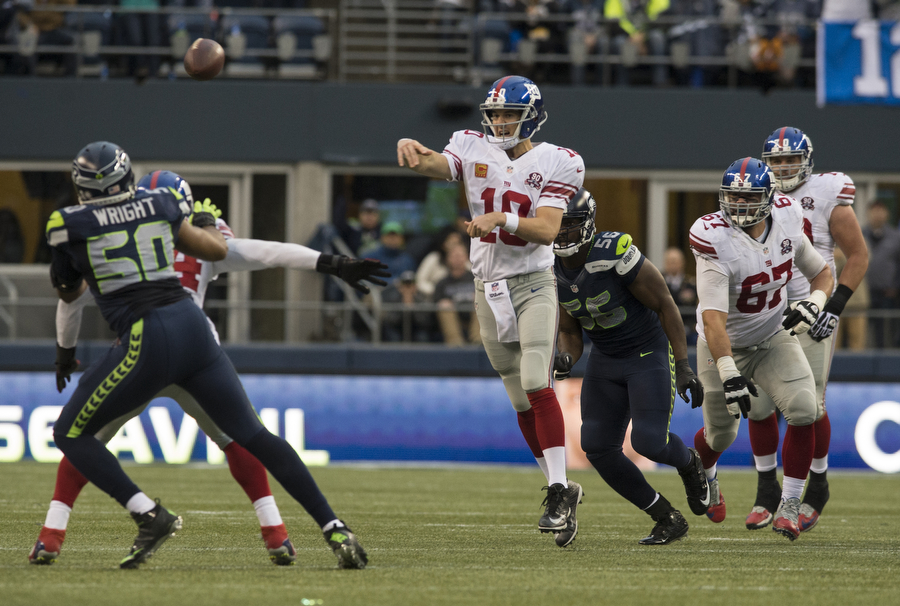 Giants quarterback Eli Manning throws the ball against the Seahawks on Sunday, Nov. 9, 2014 at CenturyLink Field.
