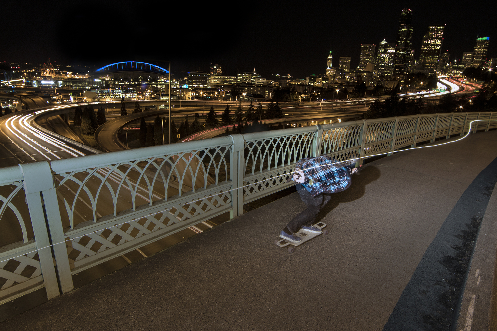 Richard Docter cruise through Seattle on his DB Longboard at night. Here's Richard riding along Dr Jose P Rizal Bridge in Beacon Hill taking in the view of Interstate-5 running through Seattle.